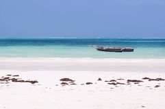 Scene of serenity at the Indian Ocean in Tanzania. Beautiful white sandy beach, torquise waters of Indian Ocean of Zanzibar, paradise place to relax and chill stock photo