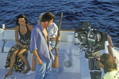 Scene from set of 'Temptation' on yacht. With guns, feature film, Miami, FL Royalty Free Stock Images