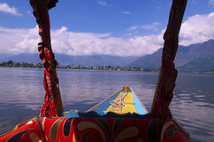 Scene from a Shikara boat. A beautiful scene of a mountain, clouds and peaceful lake from a boat Stock Photo