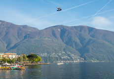 Scene side of Lake Maggiore in Switzerland. LOCARNO - APRIL 7 : Scene along lake side in Locarno, small vacation town in Switzerland, on April 7, 2017 Royalty Free Stock Photo