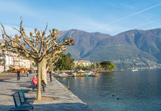 Scene side of Lake Maggiore in Switzerland. LOCARNO - APRIL 7 : Scene along lake side road in Locarno, small vacation town in Switzerland, on April 7, 2017 Stock Photos