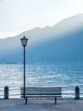 Scene side of Lake Maggiore in Switzerland. Outdoor scene view side of Lake Maggiore with bench and light pole in Locarno, Switzerland Stock Photos