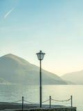 Scene side of Lake Maggiore in Switzerland. Outdoor scene view side of Lake Maggiore with light pole in Locarno, Switzerland Royalty Free Stock Photo