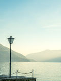 Scene side of Lake Maggiore in Switzerland. Outdoor scene view side of Lake Maggiore with light pole in Locarno, Switzerland Royalty Free Stock Images