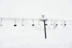 Scene of ski lift with seats  over the snow mountain Stock Images