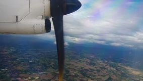 Scene from sky of the propeller aircraft. Scene from the window of the propeller aircraft seeing the cloud and land stock footage