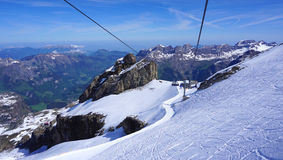 Scene of snow mountains titlis and cable car Royalty Free Stock Photography