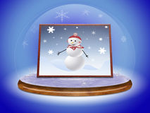 Scene snowman in glass ball Stock Photography