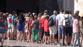Tourists waiting in line. A scene from a Spanish city stock video footage