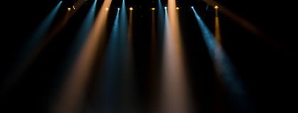 Scene, stage light with colored spotlights. A curtain theater Royalty Free Stock Image