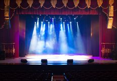 Scene, stage light with colored spotlights. And smoke royalty free stock images