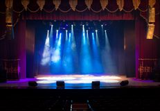 Scene, stage light with colored spotlights. And smoke Stock Photography