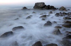 Scene with stones in sea water Royalty Free Stock Image
