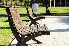 Scene of street furniture in public park. Expresses relaxation and wellbeing Royalty Free Stock Image