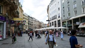 A scene in the streets of Vienna with a crowd of people royalty free stock photo