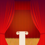 A scene with a theater curtain and pedestal. Stock Images