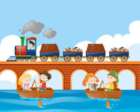 Scene with train and kids rowing boat Royalty Free Stock Photo