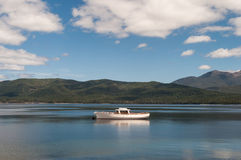 Scene tranquility of a boat on a lake Stock Photo