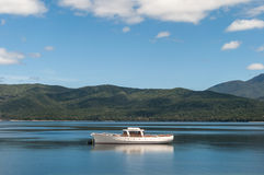 Scene tranquility of a boat on a lake Royalty Free Stock Image