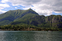 Scene of tree covered mountain and Lake Como Stock Photography