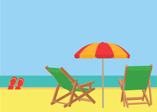 Scene on a tropical beach with deck chairs Stock Photo