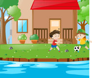 Scene with two boys playing soccer Stock Image
