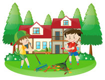 Scene with two boys raking dried leaves Stock Photos