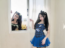 Scene with two human dolls and a window Royalty Free Stock Photos