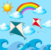 Scene with two kites and rainbow Stock Photography
