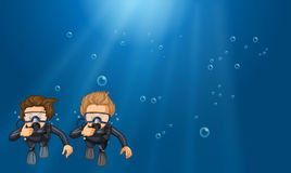 Scene with two scuba divers underwater Stock Photography