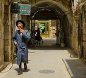 Scene of the ultra-orthodox neighborhood Mea Shearim, Jerusalem. JERUSALEM, ISRAEL - JULY 12, 2017: Scene of the ultra-orthodox neighborhood Mea Shearim, with royalty free stock images