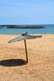 Scene with umbrella on the beach .Canary Islands.Spain. Royalty Free Stock Images