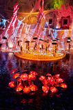 Scene with umbrellas on stage and on water Stock Images