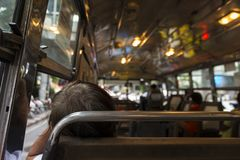 Sleeping public passengers. Scene of unidentified sleeping passengers in public omnibus of bangkok in Bangkok, Thailand Royalty Free Stock Images
