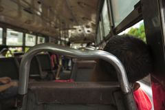 Nap bus passengers. Scene of unidentified sleeping person in public omnibus of bangkok in Bangkok, Thailand Royalty Free Stock Photos