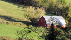 Scene in Vermont with Barn and Green Pasture Royalty Free Stock Image