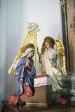 Scene of the Annunciation in a church in Forza d`Argró Stock Photos