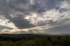 Wide angle view of the cloudy sky, sun rays sifting throug stock photography