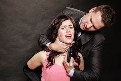 Scene of violence with firearm between men and women. Royalty Free Stock Images