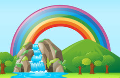Scene with waterfall and rainbow Royalty Free Stock Photography