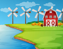 Scene with windmills on the field Stock Image