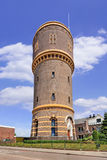 Scene wit the iconic ancient water tower, Tilburg, Netherlands. The iconic water tower in Tilburg, The Netherlands, built in 1897 and designed by architect H.P.N Royalty Free Stock Photography