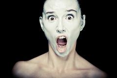 Scene of a Woman Screaming. Horror Scene of a Woman Screaming on black background Stock Image