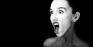 Scene of a Woman Screaming. Horror Scene of a Woman Screaming on black background Stock Photo