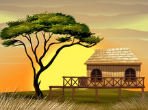 Scene with wooden hut in the field Stock Photo