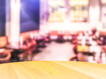 Scene of wooden table top with abstract blurred background in open restuarant. Stock Photography