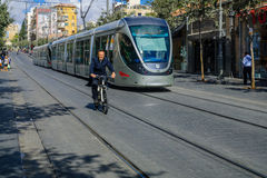 Scene of Yafo Street, Jerusalem. JERUSALEM, ISRAEL - SEPTEMBER 23, 2016: Scene of Yafo Street, with a tram, cyclist and other locals and visitors. In Jerusalem Royalty Free Stock Images