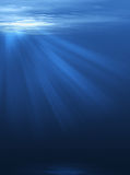 Rays of light through the depth of the sea Stock Photography