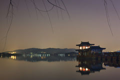 Scenerey reflected in West lake at night, Hangzhou, China Royalty Free Stock Image