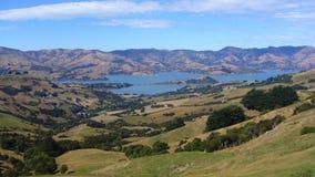Scenery. The valley near the Akaroa, New Zealand stock images